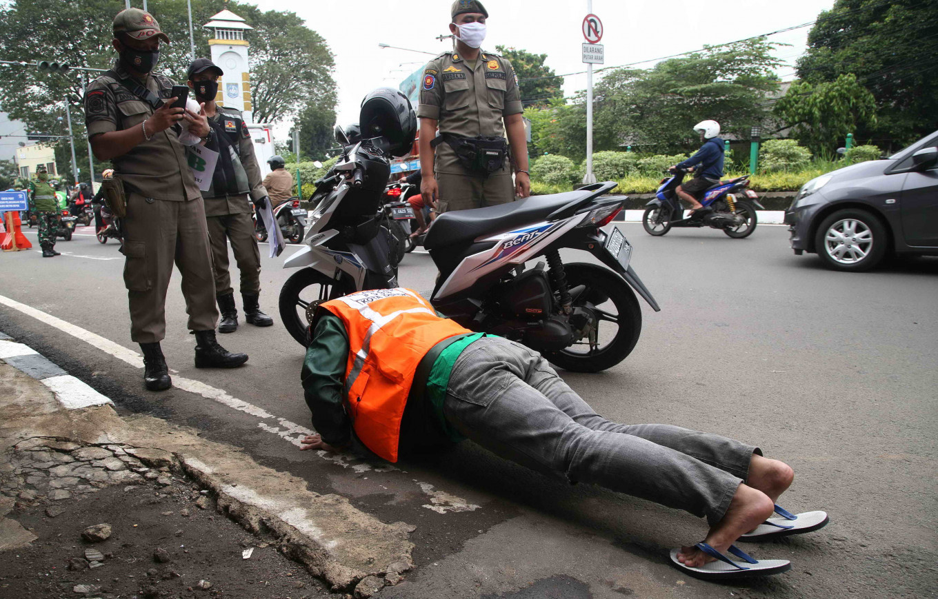 West Java looks to ease curbs despite tallying dozens of new cases