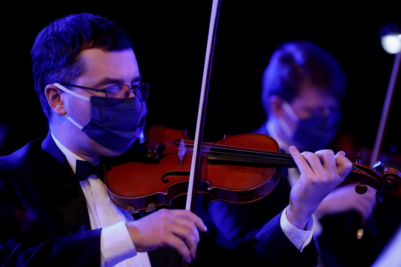 Masked Ukrainian orchestra makes concert recording as lockdown eases