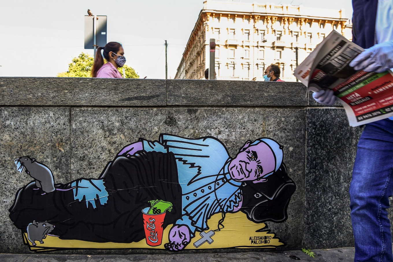 Pope Francis begs in Milan street, his cassock in tatters