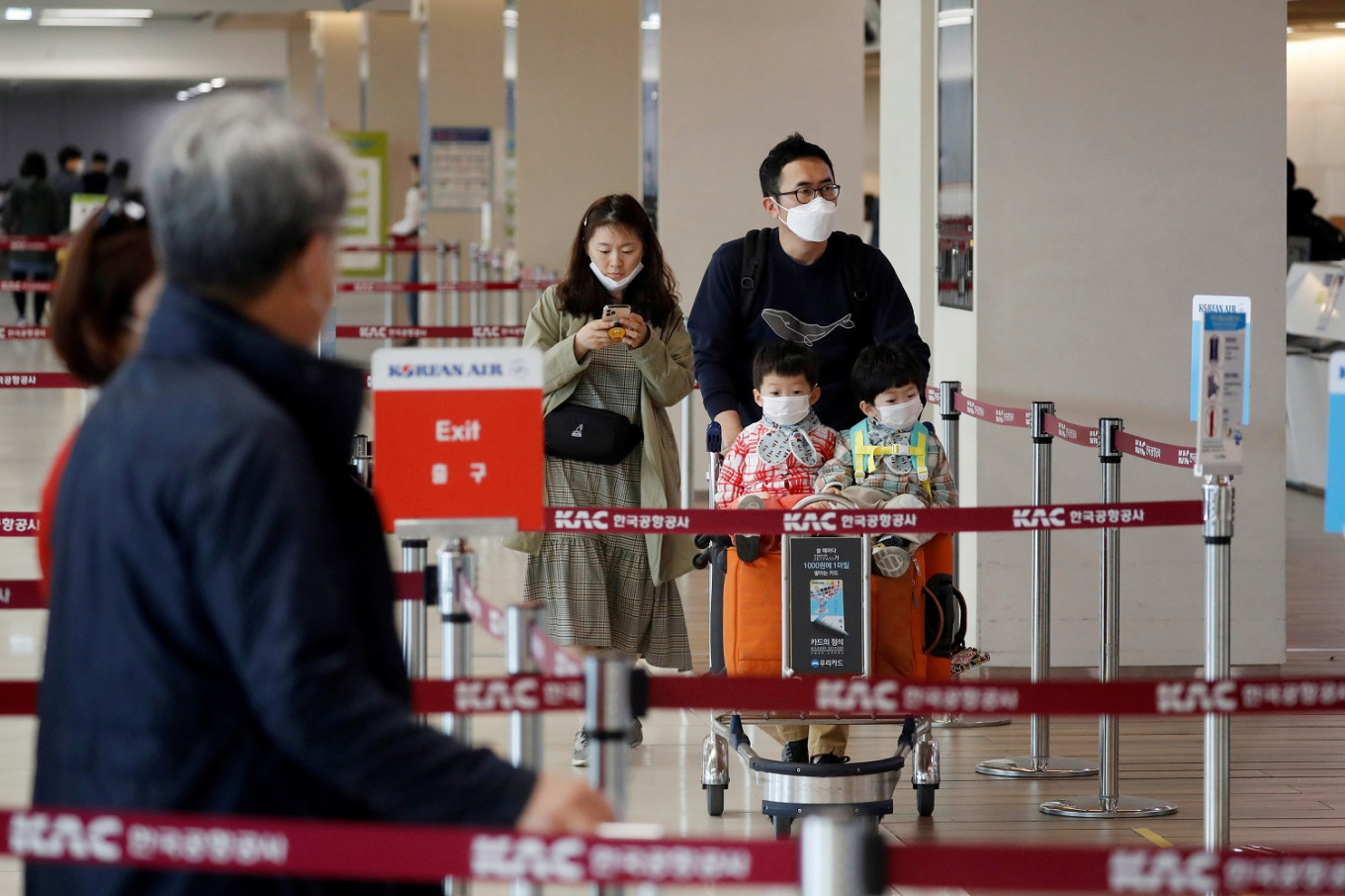 South Korea says long-term visa holders must have medical examinations before returning