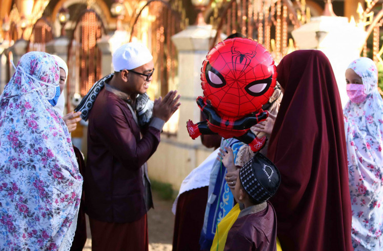 Communities met with each other after Eid al-Fitr prayer at the Jami 'Al-Makmur Mosque, Leuwinanggung - Depok, West Java on Sunday, May 24, 2020.