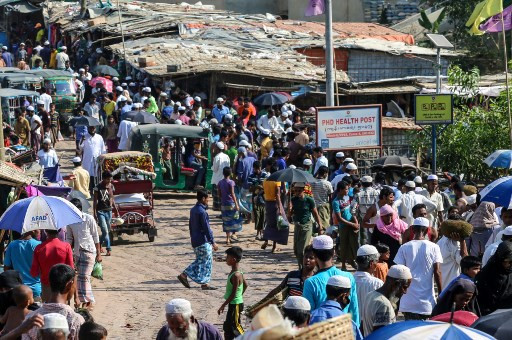 Too crowded: Rohingya refugees gather at a market on May 15, 2020, as the first cases of COVID-19 emerged in the area, in Kutupalong refugee camp in Ukhia. Some 15,000 Rohingya refugees are now under coronavirus quarantine in Bangladesh's vast camps, officials have said.