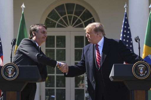 Bolsonaro follows Trump on virus, and then some