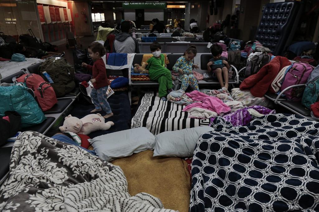 Coronavirus travel bans leave hundreds stranded at Brazil's largest airport