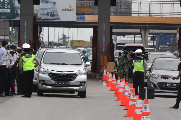 Jakarta readies sports hall to quarantine travelers returning to city without permit