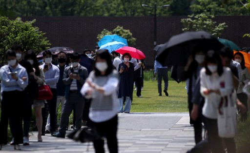 South Korea limits school numbers over virus spike