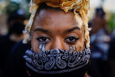 A woman with 'BLM' written on her cheek poses for a picture during a demonstration on May  31, 2020 in Atlanta, Georgia. Across the country, protests have erupted following the recent death of George Floyd while in police custody in Minneapolis, Minnesota. AFP/Getty Images/Elijah Nouvelage