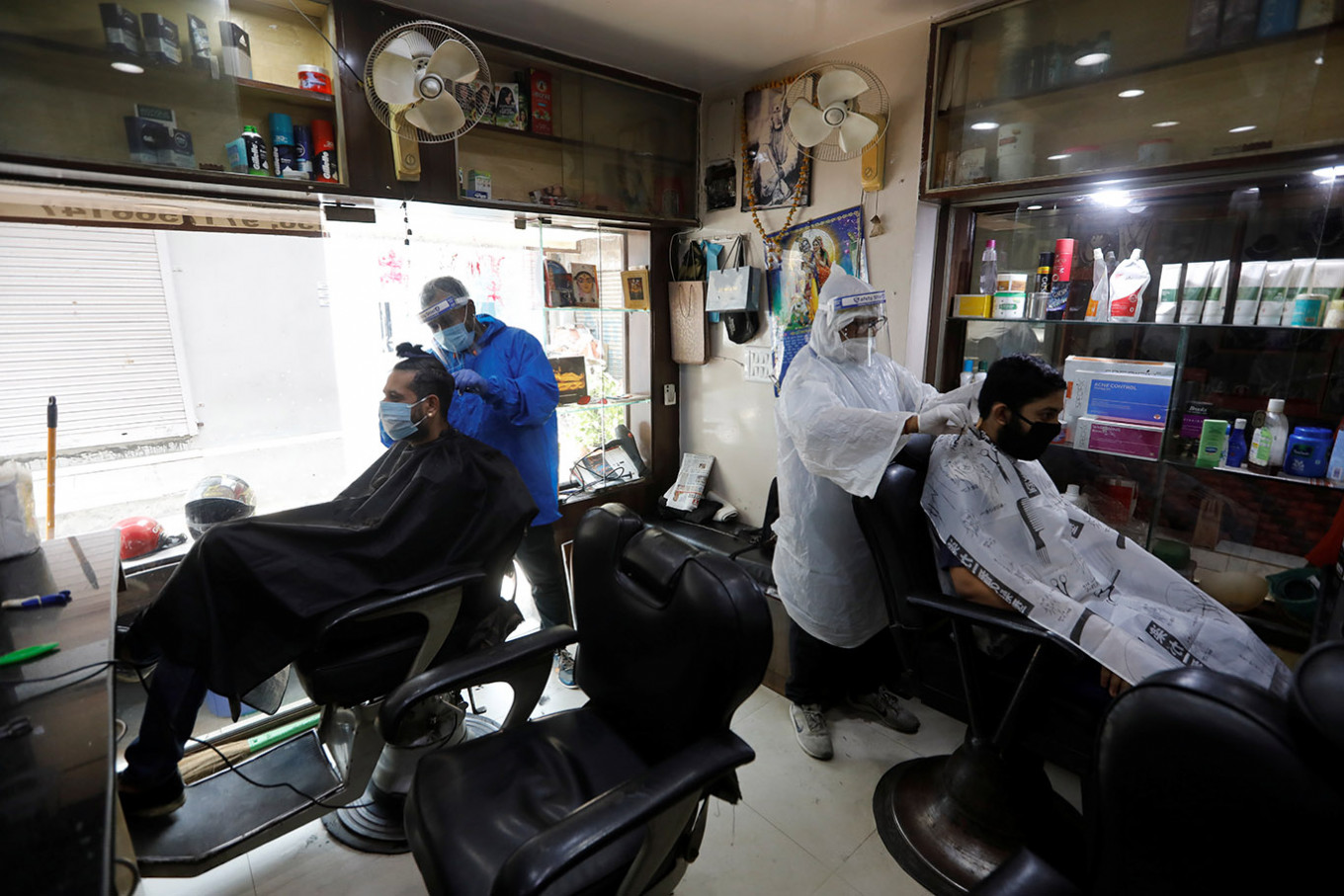 India reopens more public spaces despite record virus infections