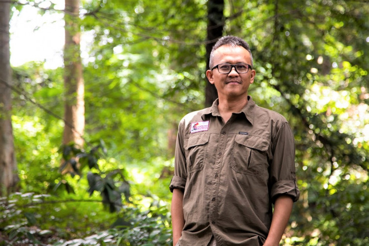 "Green champion: Yokyok ""Yoki"" Hadiprakarsa, founder and principal investigator for Rangkong Indonesia, also known as the Indonesia Hornbill Conservation Society, is working to save the critically endangered helmeted hornbill from extinction."