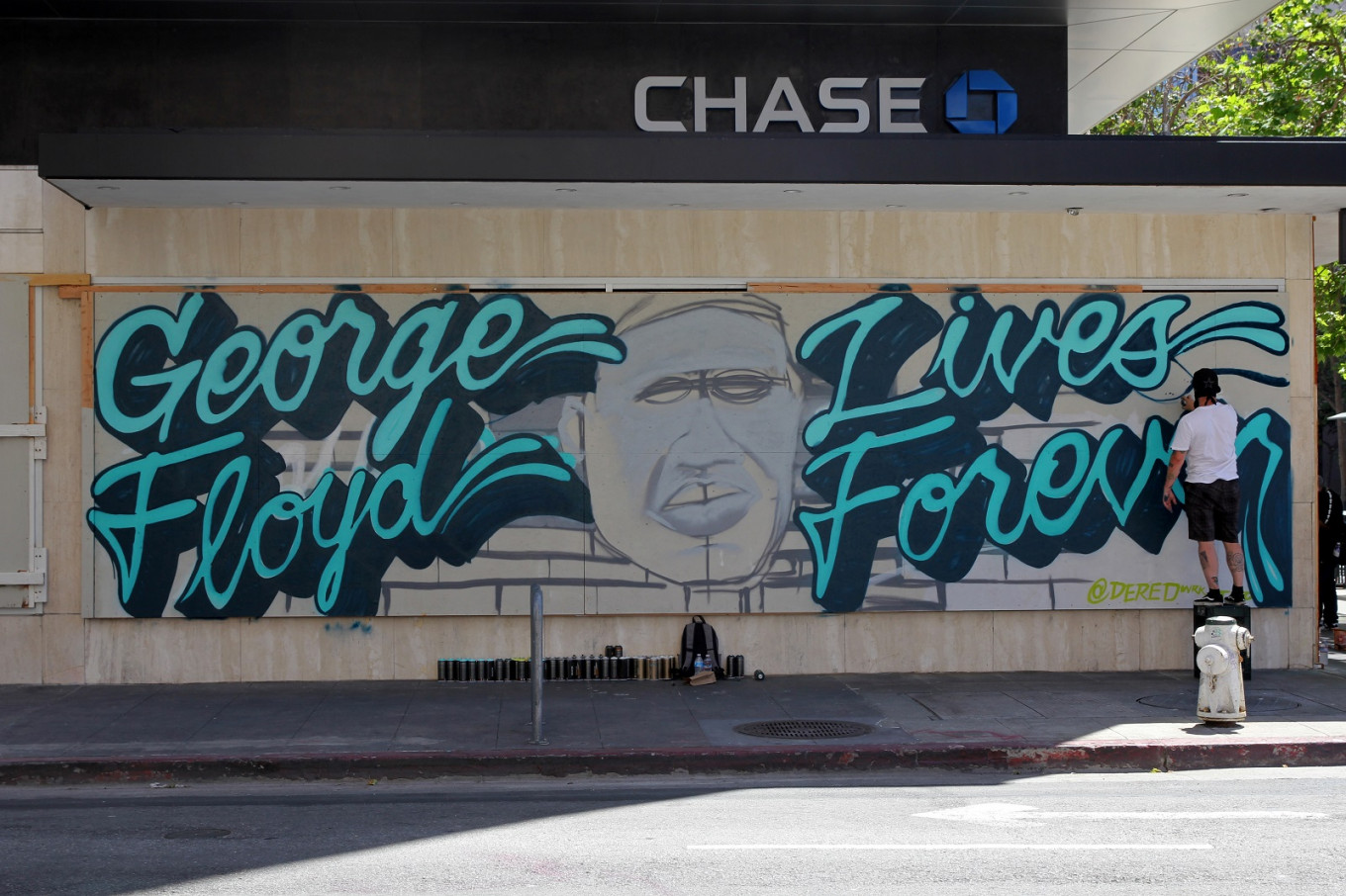 'It's all about love': Oakland artists pay tribute to George Floyd with murals