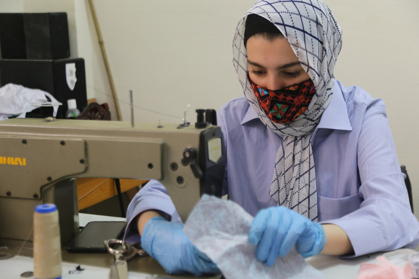 Women in Egypt's restive Sinai bring Bedouin embroidery to virus fight