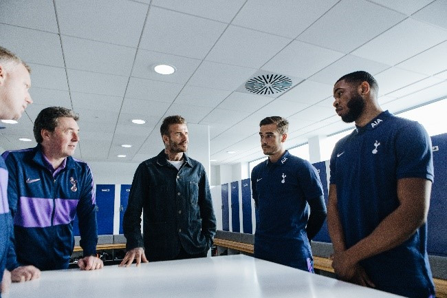 Beckham (third from left) speaks with Spurs Academy Manager Dean Rastrick and Spurs Head of Academy  Coaching and Player Development John  MC Dermott (second from left) and Spurs players.