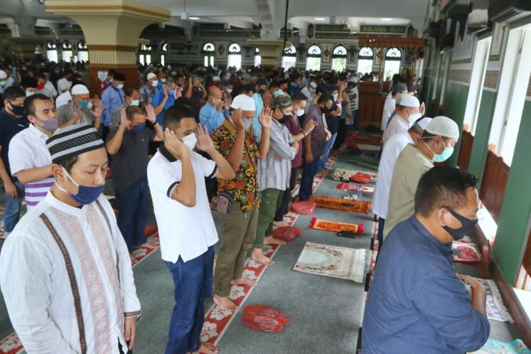 Muslims in Jakarta rejoice as mosques open for Friday prayers