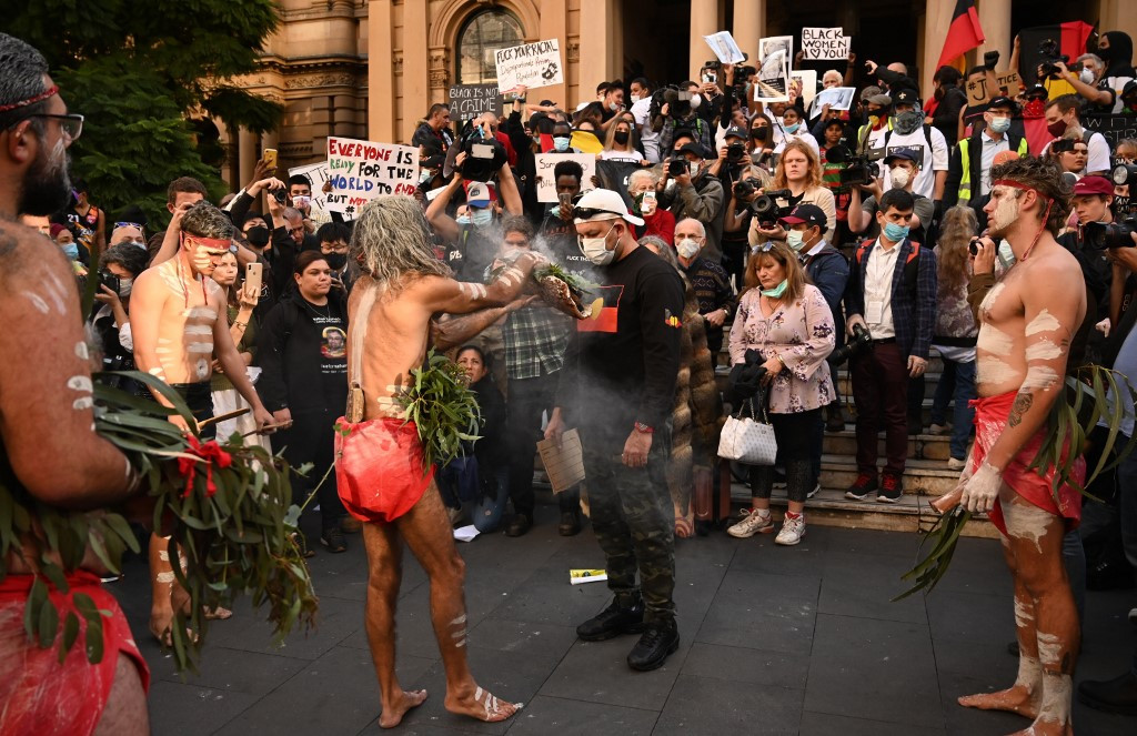Defiant Australians protest racial injustice despite warnings