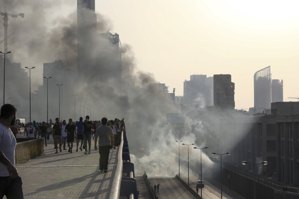 Dozens wounded in clashes as hundreds of protesters flood Beirut