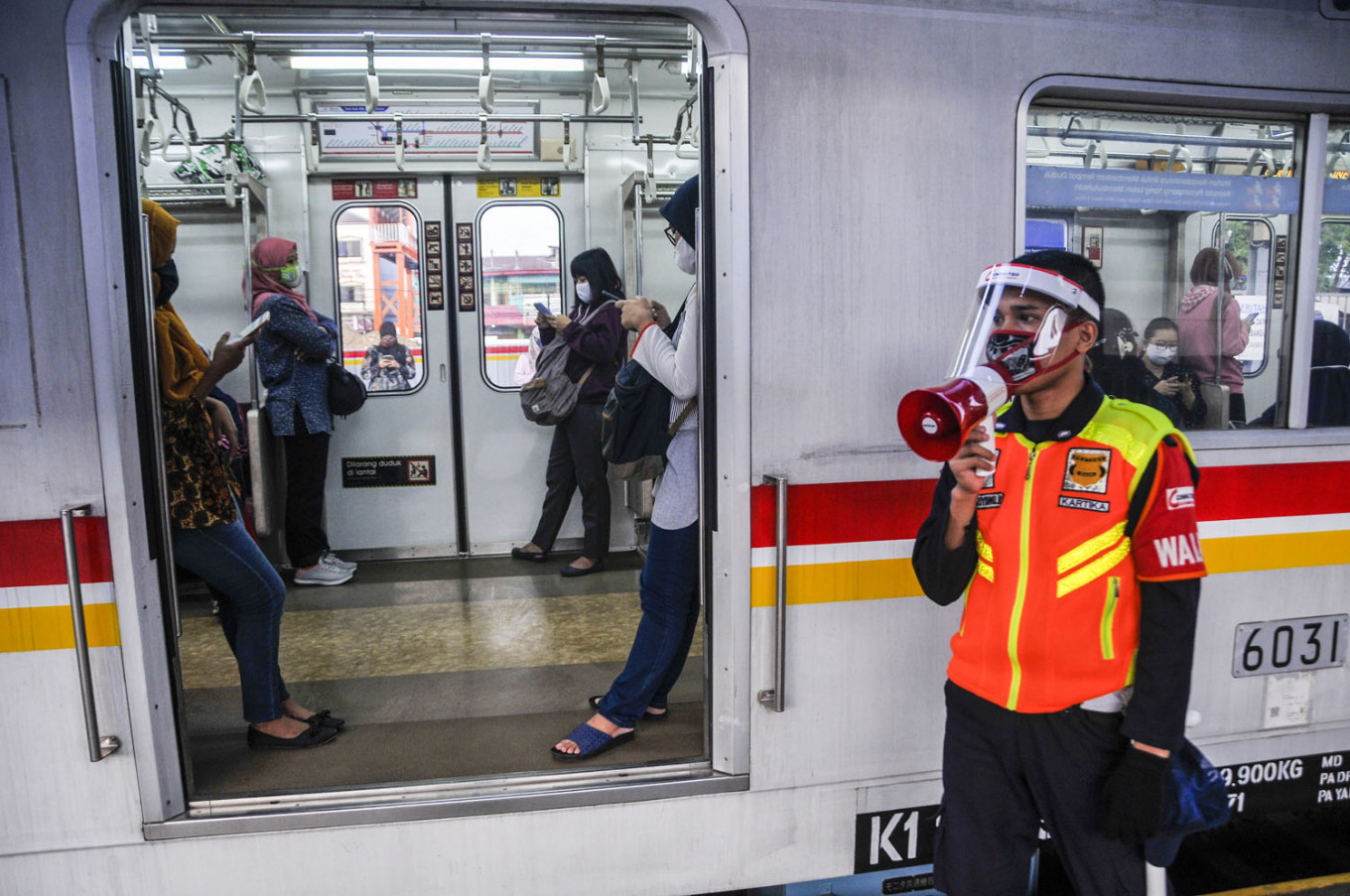 Commuters return to public transport with more protective gear
