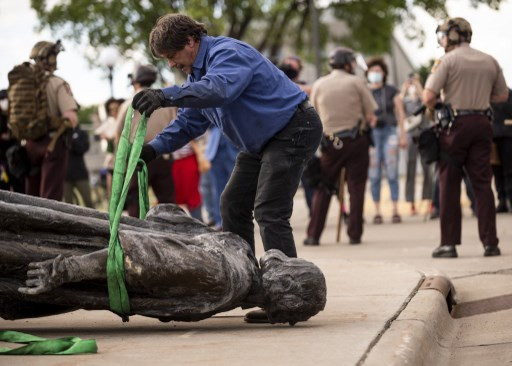 Protesters tear down Christopher Columbus statue in Saint Paul, Minnesota