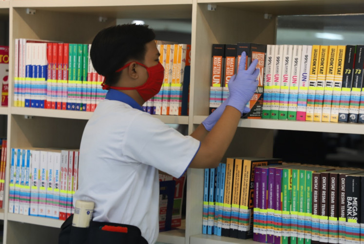 A National Library staff member prepares for reopening. The library closed its doors to the public on March 16.