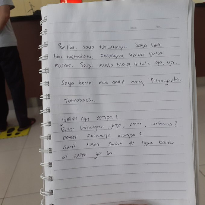 Widi Utami, 28, who has a hearing impairment,  handed this handwritten note to a security guard when she arrived at a bank in Semarang, Central Java, on June 4. While she can usually read lips, with all the security guards and tellers covering their mouth with masks, she relies on notes.