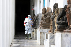 A staff member sprays disinfectant in the hallway of the National Museum in Jakarta on June 8. JP/Dhoni Setiawan