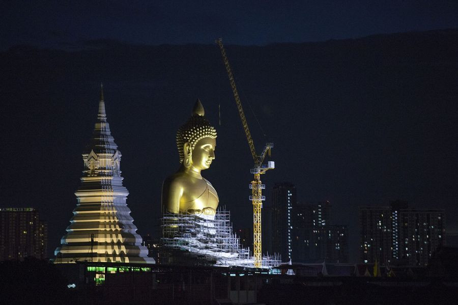 A new Buddha statue rises above Bangkok