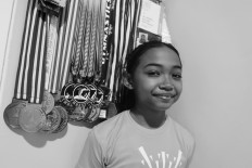 Junior gymnast Averyl Baline Mattahati, better known as Ave, poses with her medals.  JP/Toto Santiko Budi