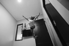Ave practices a split leap. JP/Toto Santiko Budi