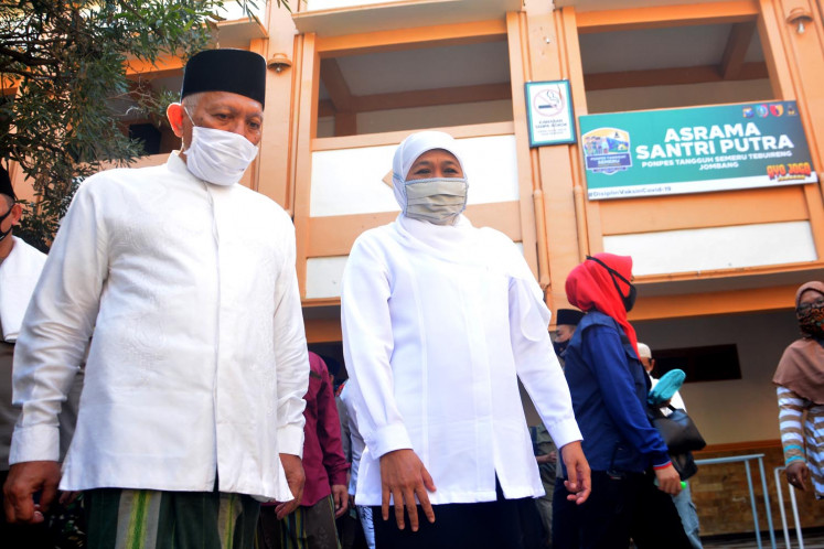 "East Java Governor Khofifah Indar Parawansa (second left) and Tebuireng Islamic boarding school official Abdul Hakim Mahfudz review ""new normal"" procedures in Jombang, East Java, on June. 16."