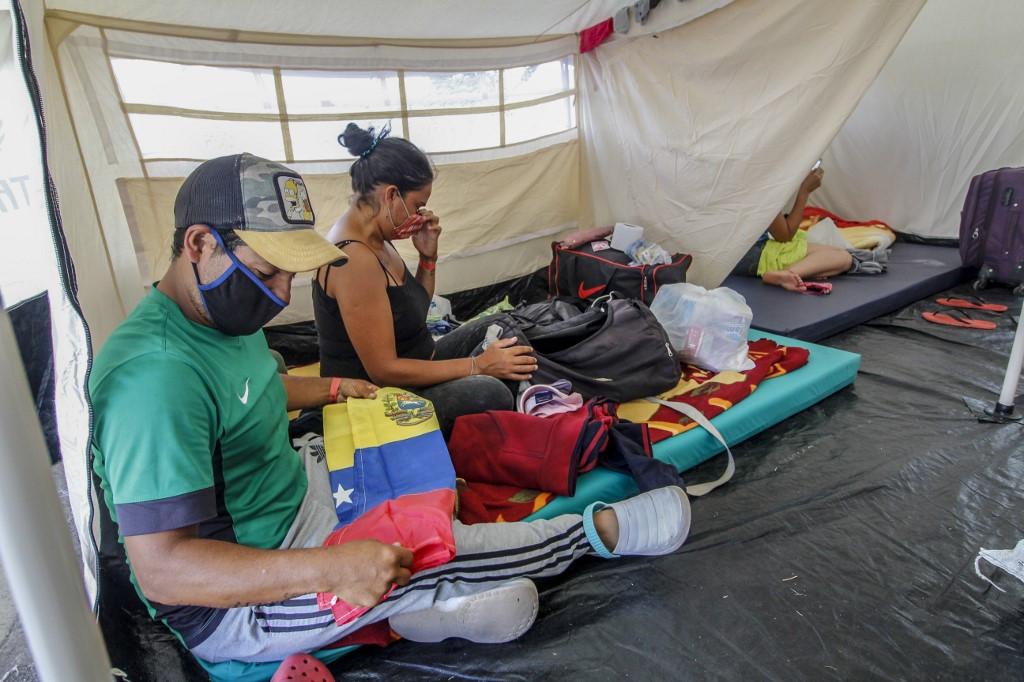 Economic carnage forecast as virus cases surge in Americas