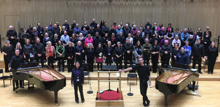 "All ready: Sarah Charista (front left) poses during the rehearsal for ""Brahms Requiem"" with members of the Royal Scottish National Orchestra."