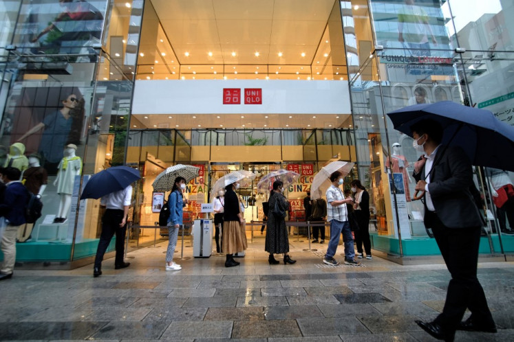 Fast Retailing cuts outlook on pandemic woes despite Uniqlo June rebound