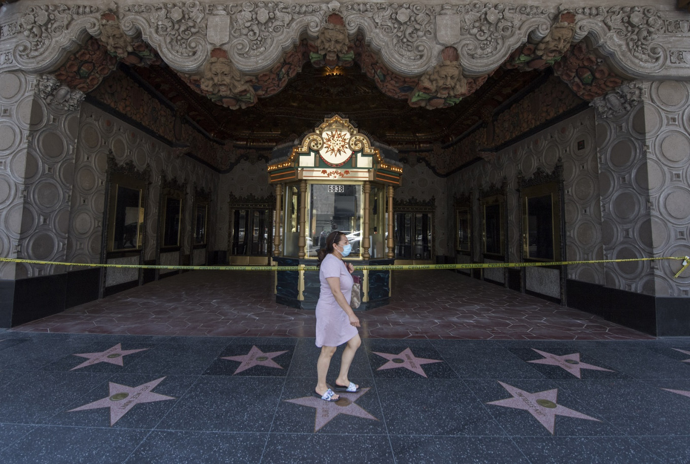 Hollywood poised for big-screen gamble as theaters reopen