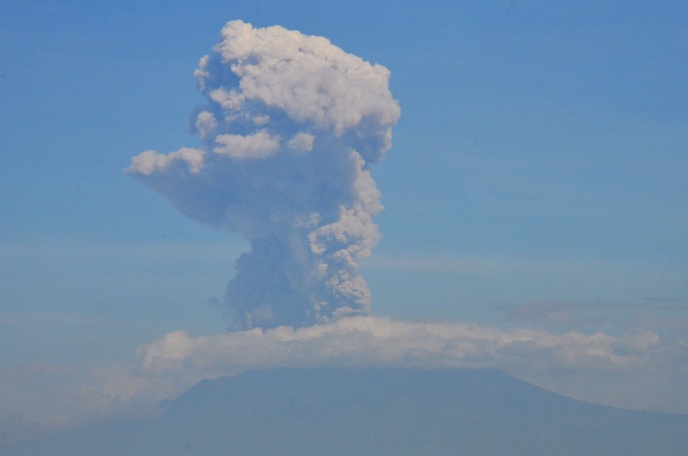 Mount Merapi erupts twice, officials advise residents to be on alert