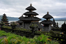 This picture taken on February 20, 2020 show a Balinese temple on the shores of Lake Batur near the village of Trunyan, home to the Trunyanese - who fuse animist beliefs and traditional village customs with their own interpretation of Hinduism - in Bangli Regency on Indonesia's Bali island. - For centuries Bali's Trunyanese people have left their dead to decompose in the open air, the bodies placed in bamboo cages until only the skeletons remain -- a ritual they haven't given up -- even as the COVID-19 pandemic upends burial practices worldwide.  AFP/Sonny Tumbelaka