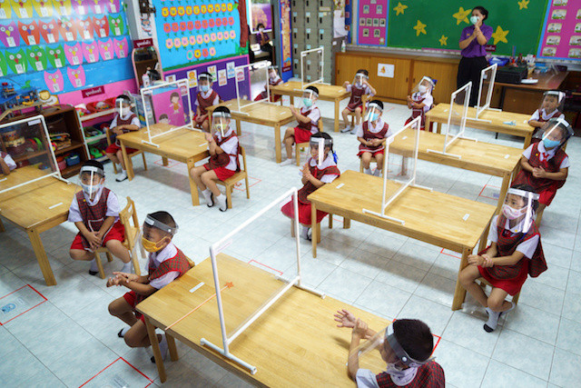Thai kids rehearse school return with sanitizers, screens and face shields