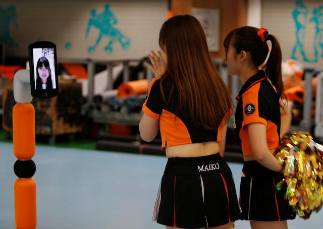 Japanese baseball fan enters empty stadium via robot