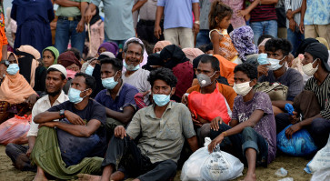 Rohingya stranded off Indonesia undergo COVID testing, given shelter