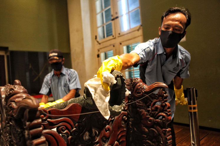 Prevention: Workers clean pieces of an collection at the Jakarta History Museum, also known as Fatahilah, on June 7.