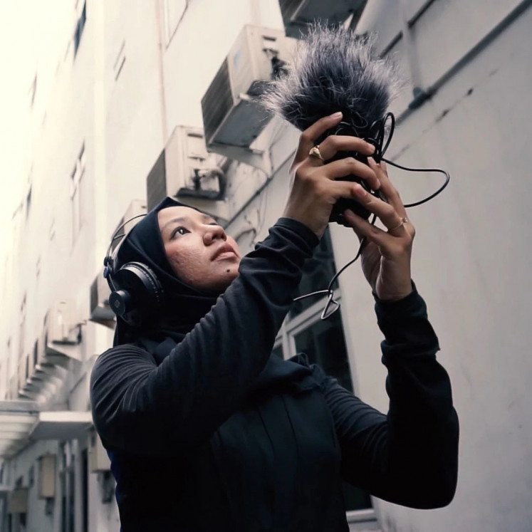 In motion: Indonesian sound engineer Rani Fitriana Jambak records sounds from a neighborhood in Medan, North Sumatra, for Goethe-Institut's Sound of X digital project.