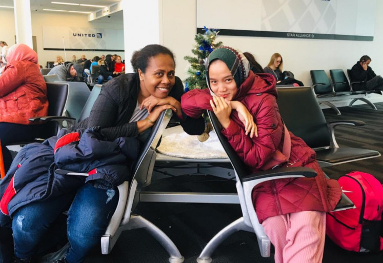Yuliana Langowuyo (left) and her friend Caca pose for the camera at Tulsa international airport in Oklahoma, the United States, while waiting for their flight to Albuquerque, New Mexico to attend an event held by the US mission to Indonesia. Yuliana is actively involved in advocating for human rights, justice and peace in Papua.