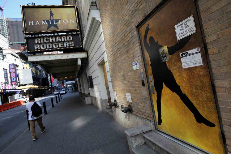 A man walks past the shuttered Richard Rodgers Theatre, home of the popular musical