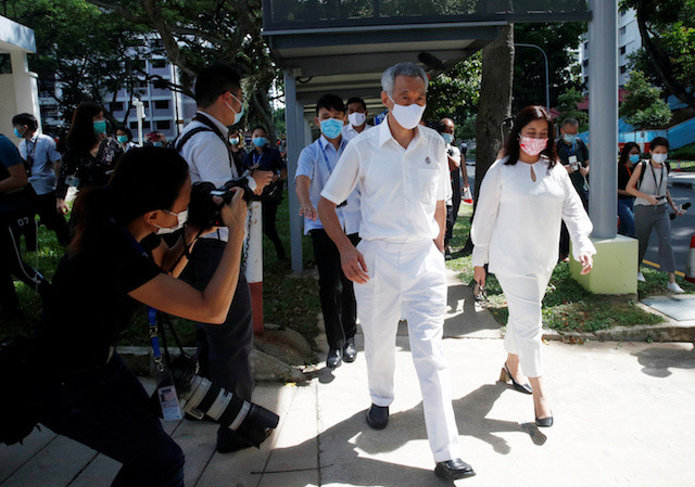 Face masks and fist bumps: Singapore's pandemic poll