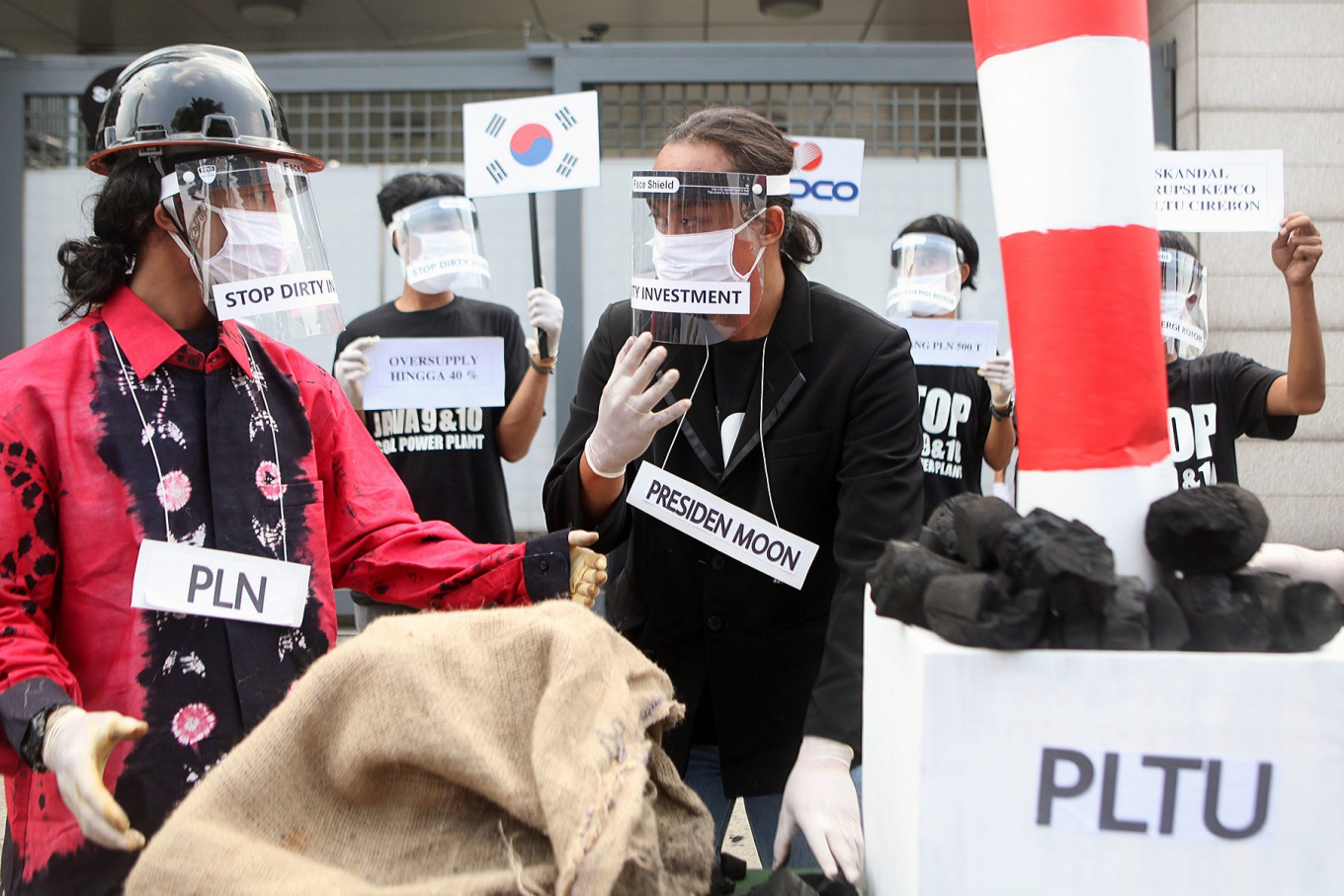 "Activists from the Civil Society Coalition (Koalisi Masyarakat Sipil) stage a protest in front of the South Korean Embassy in Jakarta on June 30. The coalition opposed the construction of coal-fired power stations, known as the Java 9 and 10 PLTU, which they argued would damage the environment and people's health with their ""dirty energy"". JP/Seto Wardhana"