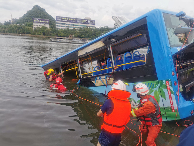 Toll rises from rain storms in China as student bus plunges into reservoir