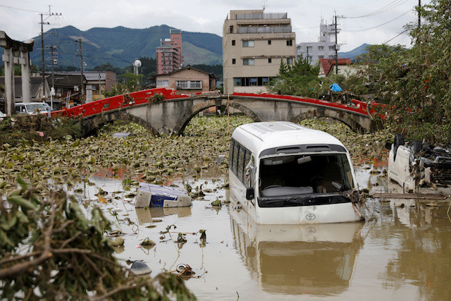 Rain pounds central Japan, 55 feared dead in south