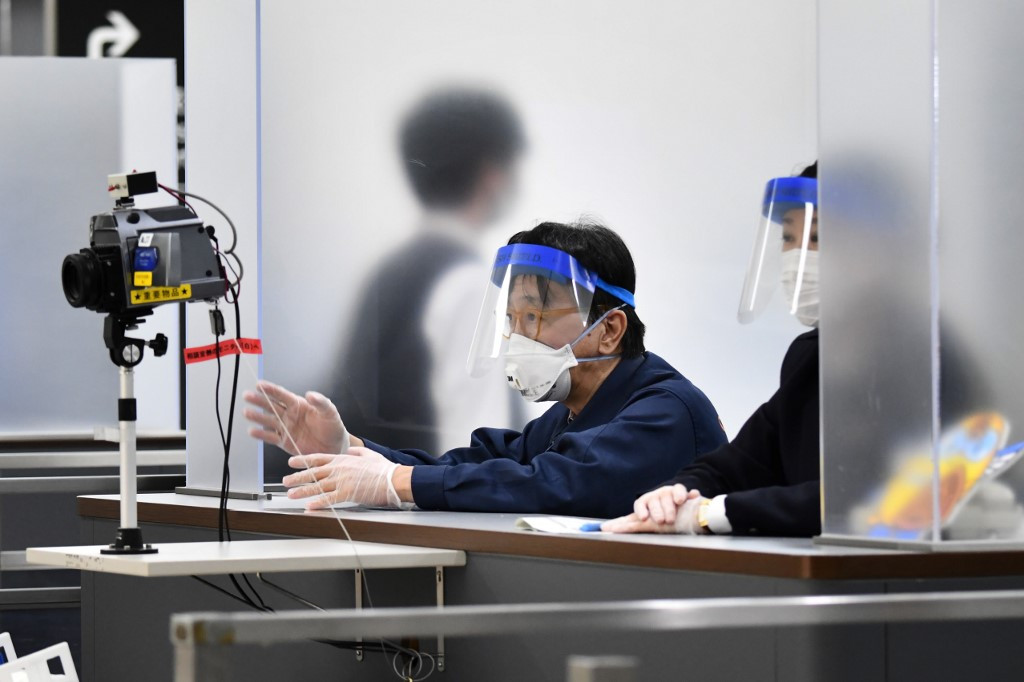Japan plans to expand airport PCR testing capacity to 10,000 per day