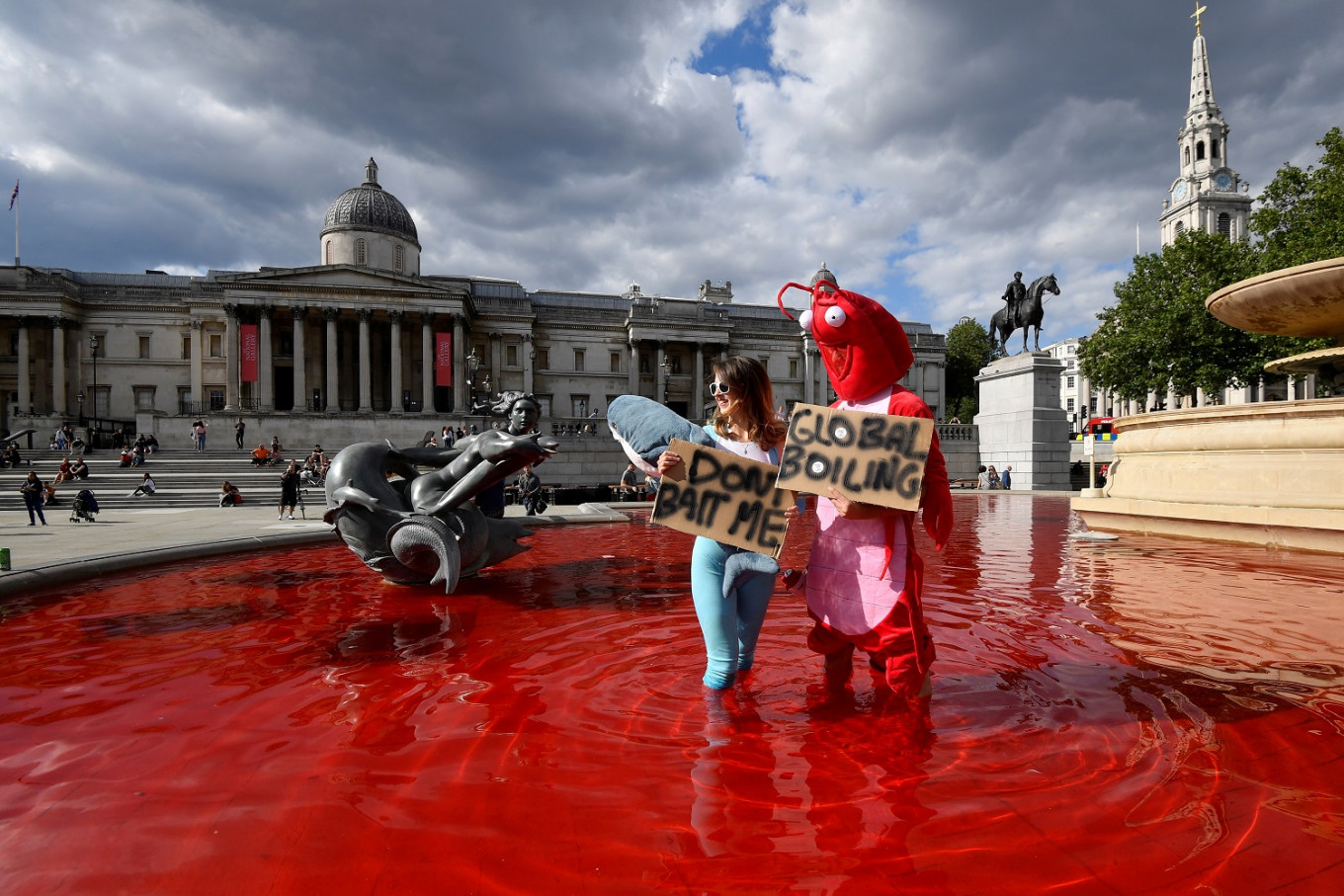 Animal rights protesters dye fountains red in London's Trafalgar Square