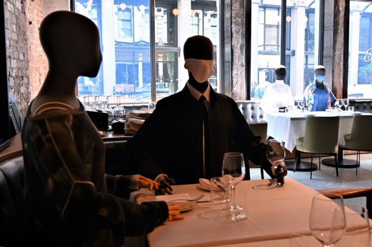 Mannequins do double duty in a chic restaurant in virus-hit Montreal