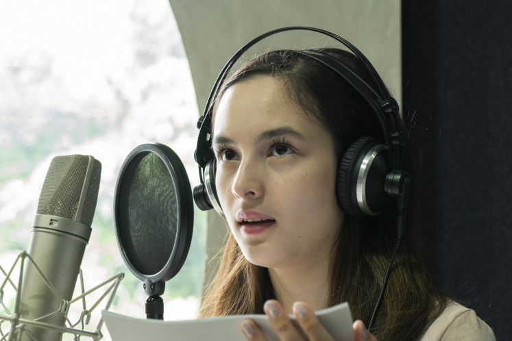 Deep in her role: Actress Chelsea Islan records her lines for Sandiwara Sastra, in which she voices Lalita from Ayu Utami's novel of the same title.