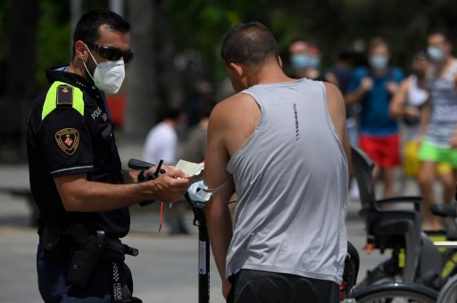 Spain region orders lockdown as global infections gather pace